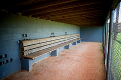 Dugout Empty. Empty dugout bench at a baseball field stock image