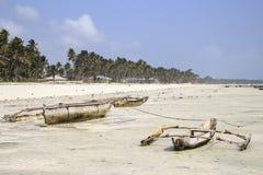 Dugouts on the beach in Zanzibar Stock Image