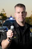 DUI Breath test. A police officer holds up a breath test machine at a DUI stop Royalty Free Stock Photos