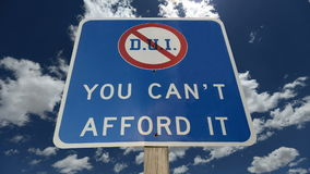 DUI You Can't Afford It Warning Sign with Time Lapse Clouds.  stock video