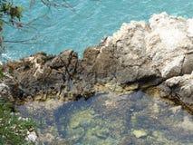 Duidelijk die water uit het overzees wordt genomen Stock Foto's