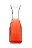 Duidelijke glasfles met rood granaatappelsap. royalty-vrije stock afbeeldingen