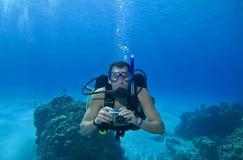 Duiker met camera, Cozumel, Mexico Stock Foto's