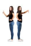Duimen omhoog en duimen onderaan contrast Stock Foto's