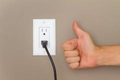 Duimen omhoog en Elektrische kabel Stock Afbeelding