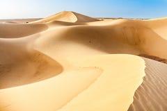 Duinen van de woestijn van de Sahara in Marokko royalty-vrije stock foto's