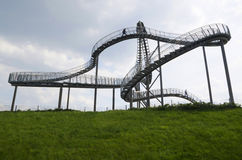 Duisburg, Germany - May 17, 2015: Tiger and Turtle sculpture in. Tiger and Turtle Roller coaster magic Mountain with people visiting it. This sculpture is an art Royalty Free Stock Images