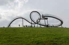 Duisburg, Germany - May 17, 2015: Tiger and Turtle sculpture in. Tiger and Turtle Roller coaster magic Mountain with people visiting it. This sculpture is an art Stock Photo