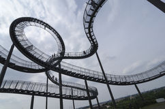 Duisburg, Germany - May 17, 2015: Tiger and Turtle sculpture in. Tiger and Turtle Roller coaster magic Mountain with people visiting it. This sculpture is an art Stock Images