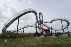 Duisburg, Germany - May 17, 2015: Tiger and Turtle sculpture in. Tiger and Turtle Roller coaster magic Mountain with people visiting it. This sculpture is an art Royalty Free Stock Photos