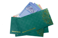 Duit raya isolated on white background. 'Duit Raya' is money given from adult to children during Eid al-Fitr celebration in Malaysia. This is a Malay tradition Stock Photo