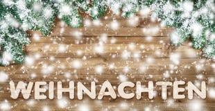 Duits woord voor Kerstmis, met hout en sneeuw Royalty-vrije Stock Afbeeldingen