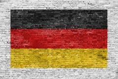 Duitse die vlag over bakstenen muur wordt geschilderd royalty-vrije stock foto's