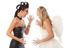 Duivel en engel het vechten Stock Afbeelding