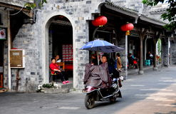 Dujiangyan, China: Woman Riding Motorcycle Stock Images