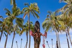 Duke. Statue with palm trees in waikiki beach honolulu Royalty Free Stock Photo