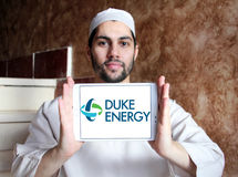 Duke energy company logo. Logo of energy and home services company duke energy on samsung tablet holded by arab muslim man stock photos