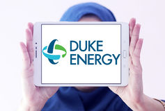 Duke energy company logo. Logo of energy and home services company duke energy on samsung tablet holded by arab muslim woman stock photo