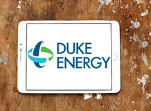 Duke energy logo. Logo of energy and home services company duke energy on samsung tablet on wooden background royalty free stock photo