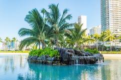 Duke Kahanamoku Lagoon. Little island located in the Duke Kahanamoku Lagoon next to the Hilton Hawaiian Village Resort, Waikiki, Hawaii Royalty Free Stock Image