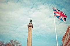 Duke of York Column in London next to Union Jack - London Royalty Free Stock Photo
