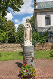Dukla, Poland - July 20, 2016: Figure inviting Mary to pray the. Rosary in front of the parish church in Dukla, Poland Stock Photography