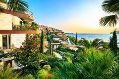 Dukley Gardens - elite real estate along Adriatic sea coast, has modern villas and luxury apartments. Rich resort on sunset, hotel Stock Photography