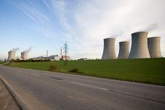 Dukovany Nuclear Power. Nuclear power plant located in Dukovany, Czech Republic.  Power plant stacks dot the roadside landscape Royalty Free Stock Photos
