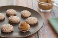 Dulce De Leche Macaron Fotos de archivo