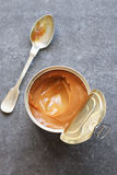 Dulce de leche in a metal tin Stock Photography