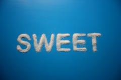 DULCE deletreado con el azúcar Imagenes de archivo