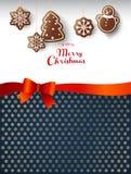 Dulces del pan de jengibre de la ejecución con deseos de la Feliz Navidad Foto de archivo