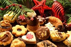 Dulces, galletas y decoración de la Navidad Imagenes de archivo