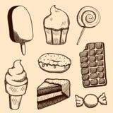 Dulces y caramelos dibujados mano Fotos de archivo