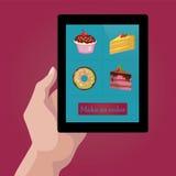 Dulces y galletas en línea de la orden vía Internet Fotos de archivo