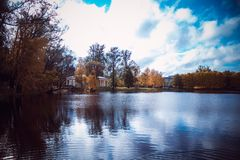 A sad autumn park in cloudy weather royalty free stock image