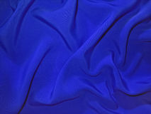 Dull blue fabric (artificial silk) royalty free stock image