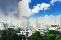 Dull city with piece of blue sky Stock Image