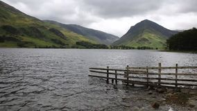 A dull overcast choppy day Buttermere English Lake District Cumbria. A dull choppy day at Buttermere English Lake District Cumbria England uk surrounded by stock video