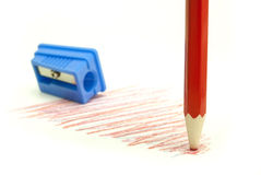 Dull pencil. Orange with blue pencil sharpener on a white background royalty free stock photo