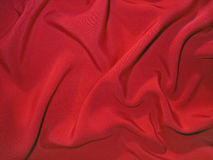 Dull red fabric (artificial silk) royalty free stock photos