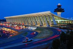 Dulles International Airport at Dusk. The soaring architecture of Eero Saarinen`s Main terminal building at Dulles International Airport glows against a dusk sky Stock Photo