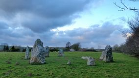 Duloe  Bronze age Stone Circle . Cornwall. It is made of eight bright white quartzite stones placed in an oval shaped circle. Stones vary in height, the largest Royalty Free Stock Photo