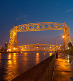 Duluth Aerial Lift Bridge. A photo of the aerial lift bridge in Duluth, Minnesota, taken at dusk. The moon is visible above the lift section Stock Photos