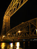 Duluth Aerial Lift Bridge. The historic Aerial Lift Bridge is seen illuminated at night in Canal Park, Duluth, Minnesota Stock Photos