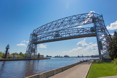Duluth aerial lift bridge with the road deck in raised position. Duluth aerial lift bridge in the raised position over the canal ready for a ship to pass through Royalty Free Stock Photography