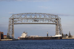 Duluth Lift Bridge & Ship. A ship coming into harbor under a lift bridge Royalty Free Stock Images