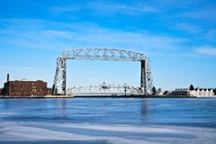 Duluth Minnesota aerial lift bridge with ice. On sunny day Royalty Free Stock Photography
