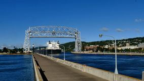 DULUTH, MN - 5 AUG 2016: Time-lapse of Iron Ore Ship arriving under iconic aerial lift bridge.