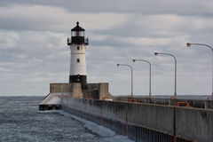 Duluth North Pier Lighthouse. The lighthouse at the end of the North Pier in Duluth, Minnesota on the shore of Lake Superior, taken from Canal Park on a cold Royalty Free Stock Photography